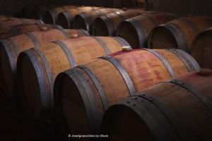 Wine barrels in an aging cellar 300x200