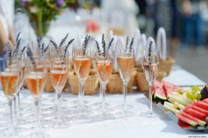Glasses of with pink champagne decorated with lavender
