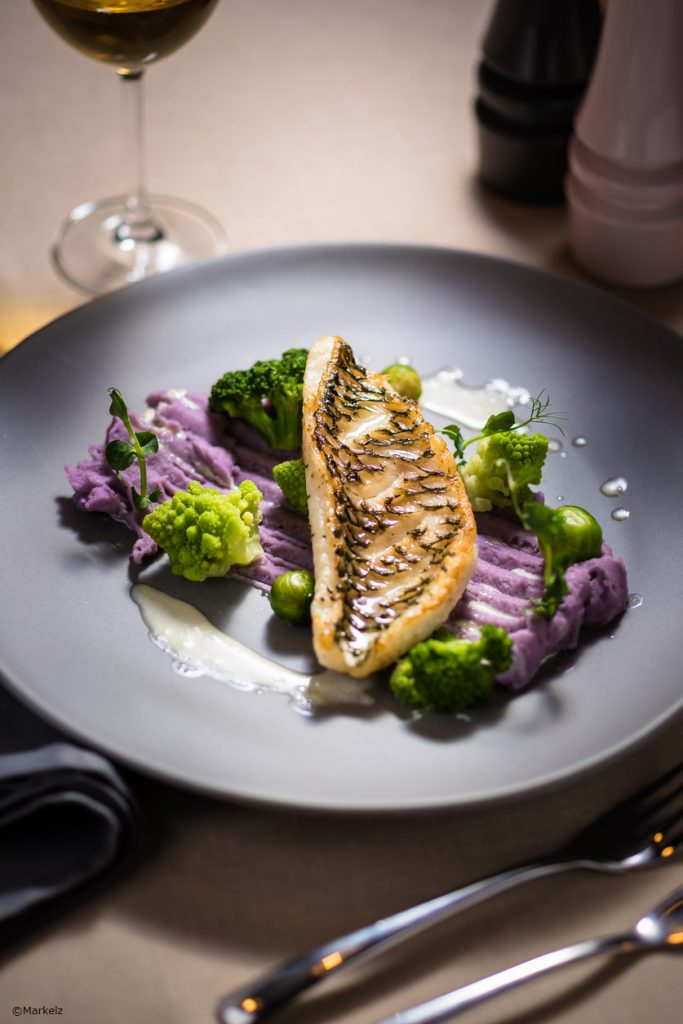 Baked parrotfish fillet with matured in wine cauliflower, served with Vitelotte potatoes and Béarnaise sauce